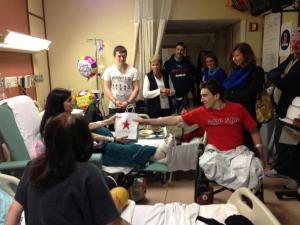 Bombing victim Jeff Bauman delivering fellow victim Sydney Corcoran her 18th birthday present